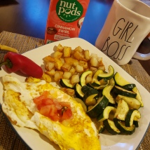 Omelette with pico de gallo, sauteed zucchini and roasted potatoes.